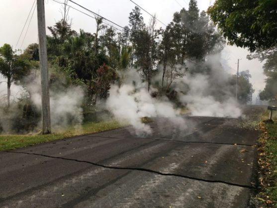 Steam rising from a fissure on Moku Street in the Leilani Estates, Hawaii