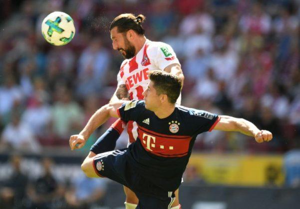Bayern Munich forward Robert Lewandowski (bottom) on his way to his 150th goal for the club, and a stern ticking off afterwards