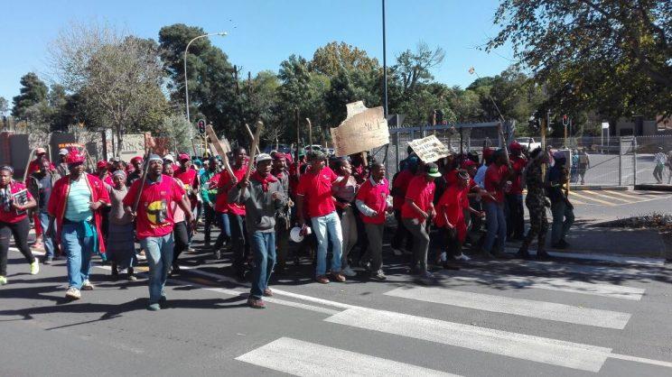The marchers arrive at Woodbridge Square.
