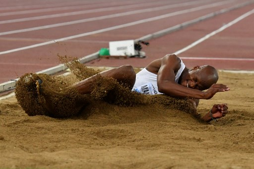 South Africa's Luvo Manyonga competes in the men's long jump event of the IAAF Diamond League 2018 Golden Gala on May 31, 2018 at the Comunal Stadio Olimpico in Rome. / AFP PHOTO / Andreas SOLARO