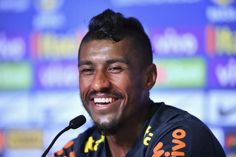 Brazil's midfielder Paulinho attends a press conference at the Yug Sports Stadium in Sochi on June 13, 2018, ahead of the Russia 2018 World Cup football tournament. / AFP PHOTO / Nelson ALMEIDA