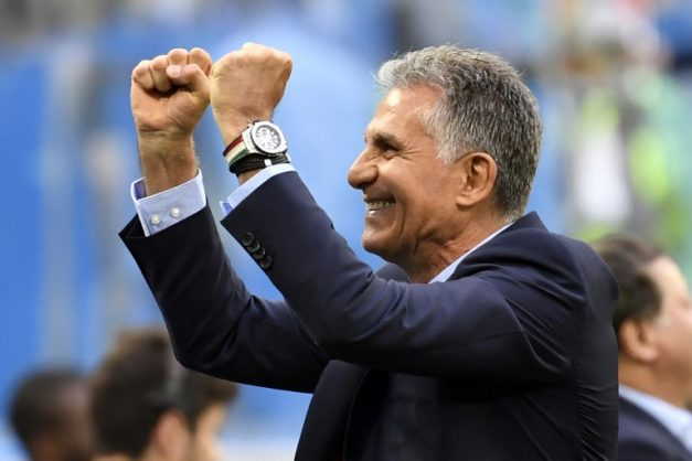 Iran's coach Carlos Queiroz celebrates at the end of the Russia 2018 World Cup Group B football match between Morocco and Iran at the Saint Petersburg Stadium in Saint Petersburg on June 15, 2018. / AFP PHOTO / CHRISTOPHE SIMON / RESTRICTED TO EDITORIAL USE - NO MOBILE PUSH ALERTS/DOWNLOADS