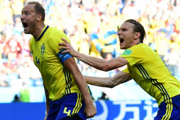 Sweden's defender Andreas Granqvist (L) celebrates after scoring a penalty during the Russia 2018 World Cup Group F football match between Sweden and South Korea at the Nizhny Novgorod Stadium in Nizhny Novgorod on June 18, 2018. / AFP PHOTO / Martin BERNETTI / RESTRICTED TO EDITORIAL USE - NO MOBILE PUSH ALERTS/DOWNLOADS