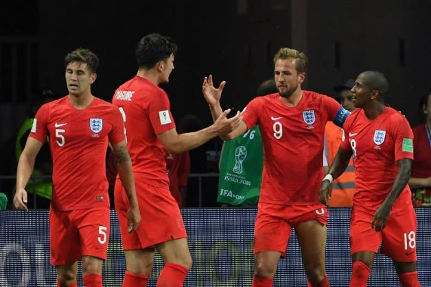 England's forward Harry Kane (2R) celebrates his second goal with teammates during the Russia 2018 World Cup Group G football match between Tunisia and England at the Volgograd Arena in Volgograd on June 18, 2018. / AFP PHOTO / Mark RALSTON / RESTRICTED TO EDITORIAL USE - NO MOBILE PUSH ALERTS/DOWNLOADS