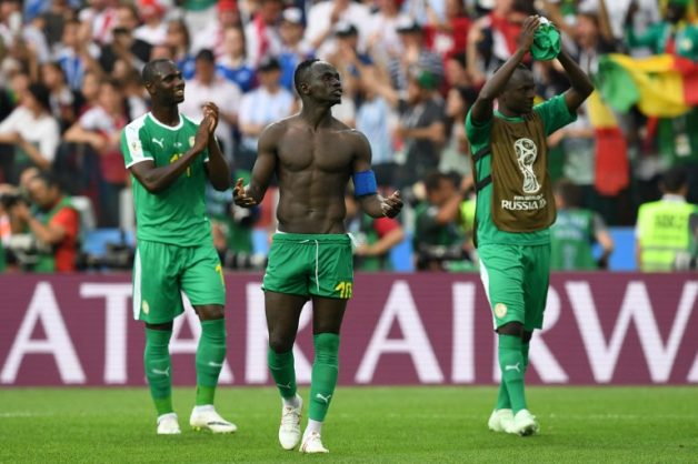 Senegal players celebrate their victory at the end of the Russia 2018 World Cup Group H football match between Poland and Senegal at the Spartak Stadium in Moscow on June 19, 2018. / AFP PHOTO / Francisco LEONG / RESTRICTED TO EDITORIAL USE - NO MOBILE PUSH ALERTS/DOWNLOADS