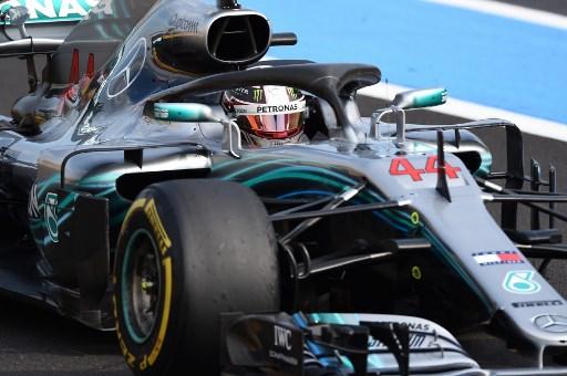 Mercedes' British driver Lewis Hamilton celebrates winning the Formula One Grand Prix de France at the Circuit Paul Ricard in Le Castellet, southern France, on June 24, 2018. / AFP PHOTO / Boris HORVAT