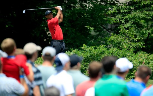 Tiger Woods watches his tee shot on the 14th hole during the final round of The Memorial Tournament Presented by Nationwide at Muirfield Village Golf Club on June 3, 2018 in Dublin, Ohio.   Andy Lyons/Getty Images/AFP