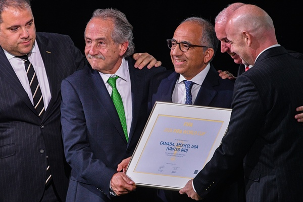 FIFA president Gianni Infantino, right, poses with the United 2026 bid (Canada-Mexico-US) officials Carlos Cordeiro (3rd R), president of the United States Football Association, president of the Mexican Football Association Decio de Maria Serrano (2nd L), Steve Reed (2nd R), president of the Canadian Soccer Association, following the announcement of the 2026 World Cup host during the 68th FIFA Congress at the Expocentre in Moscow on June 13, 2018. Picture: AFP PHOTO / Mladen ANTONOV