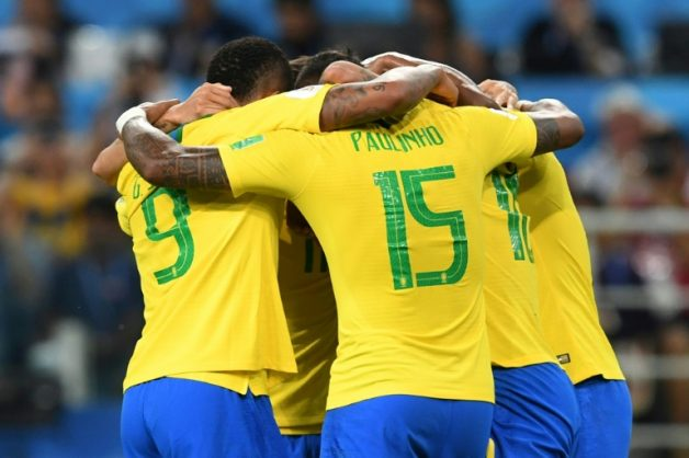 Brazil's midfielder Paulinho (C) celebrates with teammates after scoring during the Russia 2018 World Cup Group E football match between Serbia and Brazil in Moscow, landing Brazil in the final 16 for the tournament
