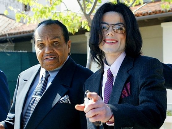 Michael Jackson, right, gestures as he and his father, Joe Jackson, leave the Santa Maria Superior Court during the second week of Michael's child molestation trial on March 8, 2005 in Santa Maria, California. Picture: Facebook