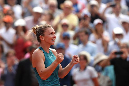 Simona Halep of Romania celebrates victory following the ladies singles final against Sloane Stephens of The United States during day fourteen of the 2018 French Open at Roland Garros on June 9, 2018 in Paris, France.  (Photo by Matthew Stockman/Getty Images)