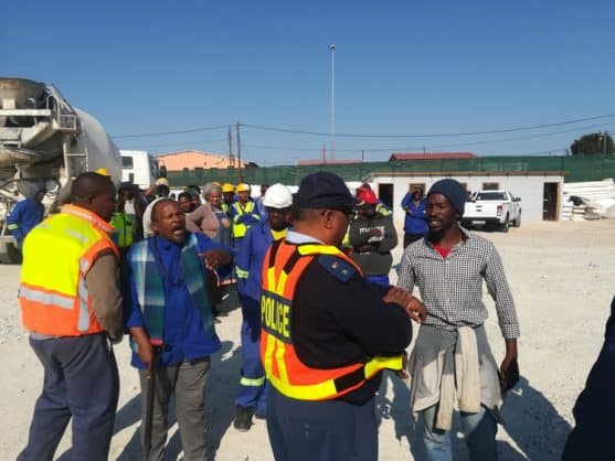 Protesters shut down the construction site of the new Nkululeko Secondary School on Tuesday afternoon claiming that only ANC members were employed to work on the site. Photo: Thamsanqa Mbovane