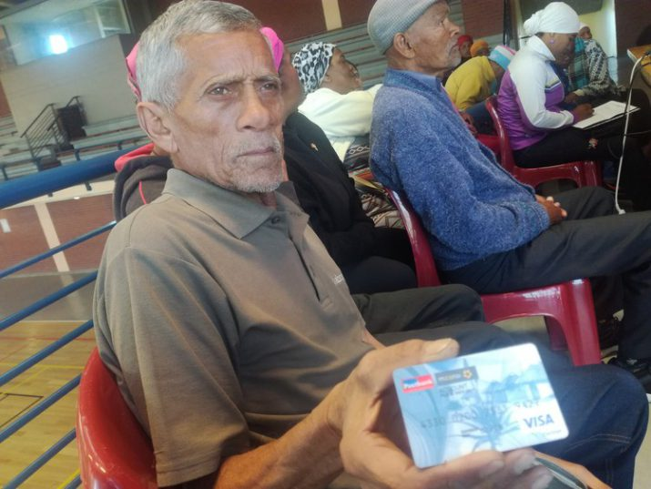 Pensioner Gerrod Henry shows his new Post Bank card, which can be exchanged for the new SASSA card when it is available. He was attending an information session hosted by the Black Sash and Right2Know in Mitchells Plain on Monday. Photo: Barbara Maregele