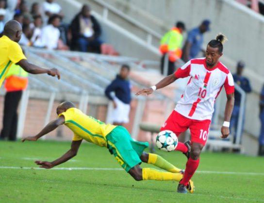 Siphesihle Ndlovu of South Africa and Andriamirado Hasina of Madagascar during the 2018 COSAFA Cup quarter final match at Peter Mokaba Stadium. (Photo by Philip Maeta/Gallo Images)