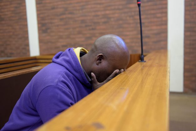 Sibusiso Tshabalala, the father who is accused of shooting his son at a school in Ennerdale is pictured seated inside the dock at the Lenasia Magistrates Court, 7 June.  He was released on a warning.  Picture: Tracy Lee Stark