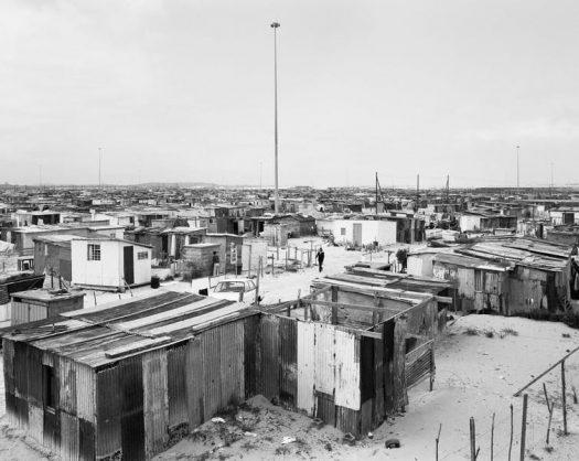 Flushing Meadows and lightning masts, Site B, Khayelitsha, Cape Town, 11 October 1987. David Goldblatt