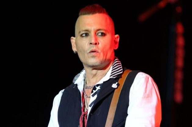 Depp is currently sporting a Mohawk and a clean shave for his rock star stage persona.
