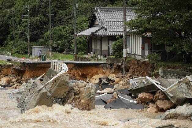 Twenty dead as record Japan rains prompt mass evacuations