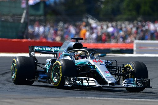 Mercedes' British driver Lewis Hamilton races during the British Formula One Grand Prix at the Silverstone motor racing circuit in Silverstone, central England, on July 8, 2018. / AFP PHOTO / Andrej ISAKOVIC