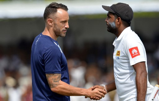 Sri Lanka's Dilruwan Perera (R) is congratulated by South Africa's captain Faf du Plessis (L) after Sri Lanka's victory in the opening Test match between Sri Lanka and South Africa at the Galle International Cricket Stadium in Galle on July 14, 2018. / AFP PHOTO / LAKRUWAN WANNIARACHCHI