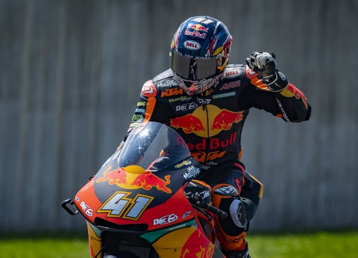South African Red Bull KTM rider Brad Binder celebrates after winning the Moto2 race at the Grand Prix of Germany at the Sachsenring Circuit on July 15, 2018 in Hohenstein-Ernstthal, eastern Germany. / AFP PHOTO / Robert MICHAEL