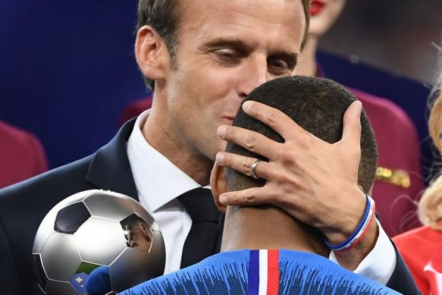 French President Emmanuel Macron (L) kisses France's forward Kylian Mbappe (R) as he presents him with the Best Young Player Award after the Russia 2018 World Cup final football match between France and Croatia at the Luzhniki Stadium in Moscow on July 15, 2018. Picture: AFP Photo / Jewel Samad.