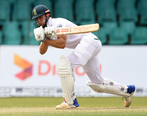 South Africa's Theunis de Bruyn plays a shot during the fourth day of the second Test match between Sri Lanka and South Africa at the Sinhalese Sports Club (SSC) international cricket stadium in Colombo on July 23, 2018. / AFP PHOTO / ISHARA S. KODIKARA