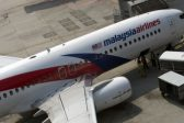 Anger as report on missing Malaysian Airlines flight MH370 provides few answers