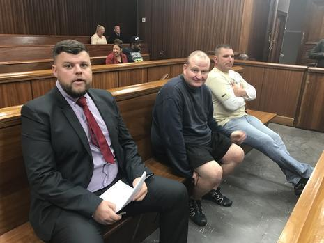 From left, alleged perlemoen smuggling kingpin Julian Brown, Eugene 'Boesman' Victor and Brandon Turner in the dock at the Port Elizabeth High Court at an earlier court appearance. Picture: ANA