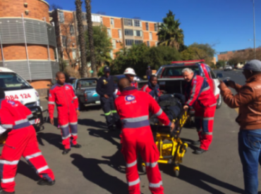 ER24 personnel loading one of the injured into an ambulance. Picture: ANA