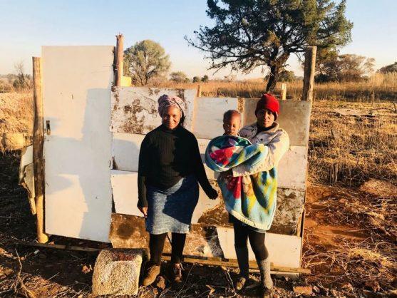 Martha Nthuli and her daughter Simpiwe stand next to the shack that they are rebuilding. Photo: Kimberly Mutandiro