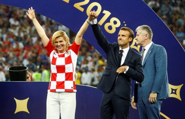 Croatian President Kolinda Grabar-Kitarovic, left, with French President Emmanuel Macron after the final of World Cup 2018 in Moscow, 15 July 2018. Picture: Twitter