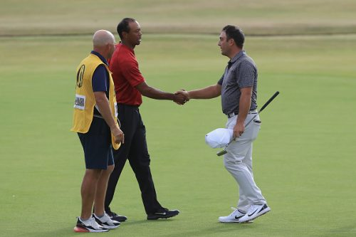 Francesco Molinari of Italy (R) is congratulated by Tiger Woods of the United States after a birdie on the 18th hole during the final round of the 147th Open Championship at Carnoustie Golf Club on July 22, 2018 in Carnoustie, Scotland.  (Photo by Sam Greenwood/Getty Images)
