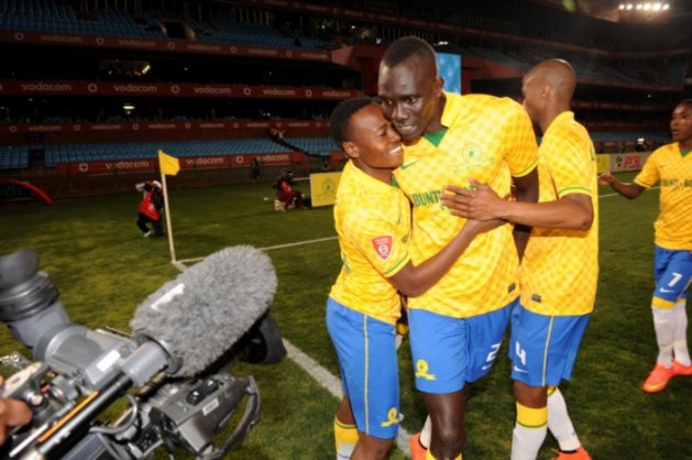 Mane Niang of Mamelodi Sundowns celebrates with his team mates during the Absa Premiership match between Mamelodi Sundowns and Maritzburg United at Loftus Stadium on August 08, 2014 in Pretoria, South Africa. (Photo by Lee Warren/Gallo Images)