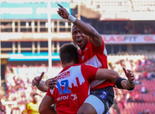 Aphiwe Dyantyi celebrates a superb try with Harold Vorster. Photo: Gallo Images.
