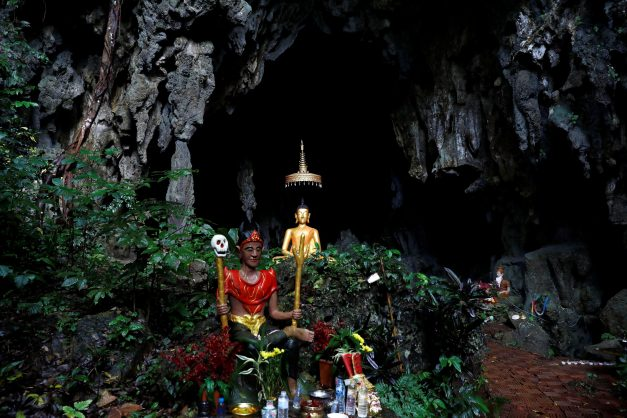A spirit and Buddha state image are seen in front of a cave near Tham Luang cave complex, as an ongoing search for members of an under-16 soccer team and their coach continues, in the northern province of Chiang Rai, Thailand, July 2, 2018. Picture: Reuters