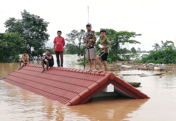 Lao villagers are stranded on a roof of a house after they evacuated floodwaters after the Xe Pian Xe Nam Noy dam collapsed in a village near Attapeu province, Laos, 24 July 2018. Several hundred people were reported missing while at least five were killed after the Xe Pian Xe Nam Noy hydroelectric dam burst, causing heavily flash floods through several villages, leaving hundreds of households submerged underwater. Picture: EPA-EFE / ABC Laos News.