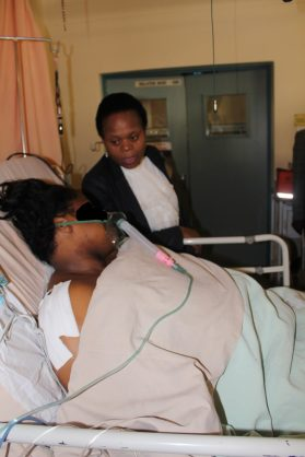 MEC for Health in Limpopo, Dr Phophi Ramathuba, visiting with the stabbed employee in ICU ward.