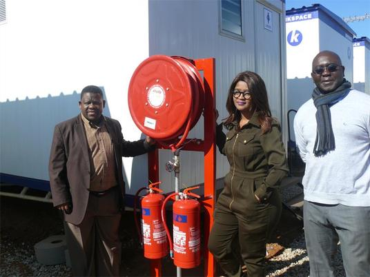 MMC for Housing Meshack van Wyk, Zanele Malusi, project manager and Emmanuel Sotomi, director of housing all excited with the progression of the prefabricated emergency accommodation units. Photo. Sibonelo Mtshali/Southern Courier