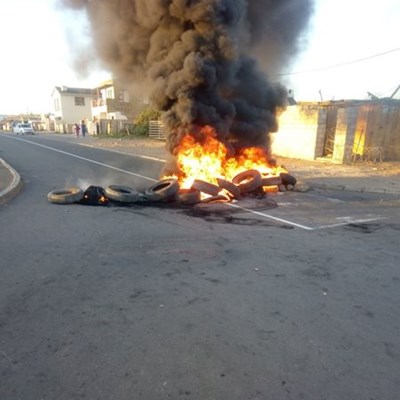 Tyres burning on Adriaans Road in Asla Park this morning.