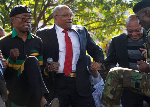 Former South African president Jacob Zuma dances after his court appearance in Pietermaritzburg, South Africa, July 27, 2018. REUTERS/Rogan Ward