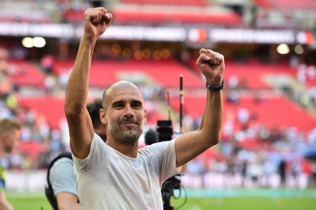 Manchester City's Spanish manager Pep Guardiola celebrates on the pitch after the English FA Community Shield football match between Chelsea and Manchester City at Wembley Stadium in north London on August 5, 2018. Manchester City won the game 2-0. / AFP PHOTO / Glyn KIRK / NOT FOR MARKETING OR ADVERTISING USE / RESTRICTED TO EDITORIAL USE
