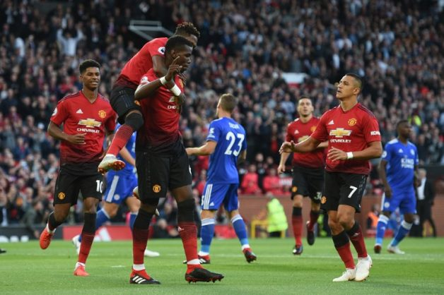 Manchester United's French midfielder Paul Pogba (C) with Manchester United's Brazilian midfielder Fred (2L) and Manchester United's Chilean striker Alexis Sanchez (R) after scoring the opening penalty during the English Premier League football match between Manchester United and Leicester City at Old Trafford in Manchester, north west England, on August 10, 2018. / AFP PHOTO / Oli SCARFF / RESTRICTED TO EDITORIAL USE. No use with unauthorized audio, video, data, fixture lists, club/league logos or 'live' services. Online in-match use limited to 120 images. An additional 40 images may be used in extra time. No video emulation. Social media in-match use limited to 120 images. An additional 40 images may be used in extra time. No use in betting publications, games or single club/league/player publications. /