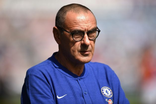 Chelsea's Italian head coach Maurizio Sarri looks on before the English Premier League football match between Huddersfield Town and Chelsea at the John Smith's stadium in Huddersfield, northern England on August 11, 2018. / AFP PHOTO / Oli SCARFF / RESTRICTED TO EDITORIAL USE.No use with unauthorized audio, video, data, fixture lists, club/league logos or 'live' services. Online in-match use limited to 120 images. An additional 40 images may be used in extra time. No video emulation. Social media in-match use limited to 120 images. An additional 40 images may be used in extra time. No use in betting publications, games or single club/league/player publications/ /