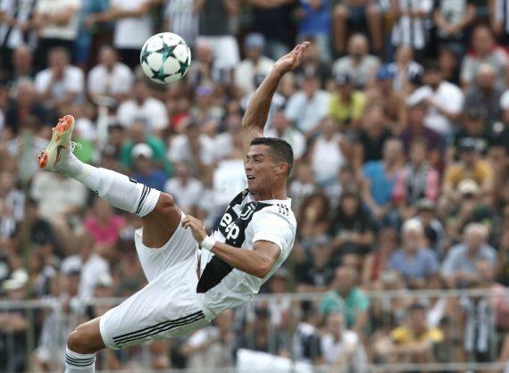 Juventus' forward from Portugal Cristiano Ronaldo kicks the ball during the friendly football match between Juventus A and Juventus B at Villar Perosa, on August 12, 2018 at Villar Perosa. / AFP PHOTO / Isabella Bonotto