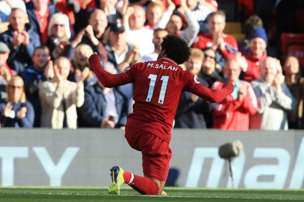 Liverpool's Egyptian midfielder Mohamed Salah celebrates scoring the opening goal during the English Premier League football match between Liverpool and Brighton and Hove Albion at Anfield in Liverpool, north west England on August 25, 2018. / AFP PHOTO / Lindsey PARNABY / RESTRICTED TO EDITORIAL USE. No use with unauthorized audio, video, data, fixture lists, club/league logos or 'live' services. Online in-match use limited to 120 images. An additional 40 images may be used in extra time. No video emulation. Social media in-match use limited to 120 images. An additional 40 images may be used in extra time. No use in betting publications, games or single club/league/player publications. /