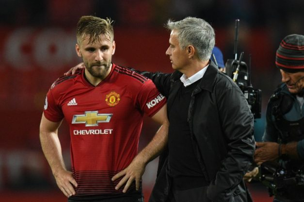 Manchester United's Portuguese manager Jose Mourinho (R) greets Manchester United's English defender Luke Shaw (L) after the final whistle in the English Premier League football match between Manchester United and Tottenham Hotspur at Old Trafford in Manchester, north west England, on August 27, 2018. / AFP PHOTO / Oli SCARFF / RESTRICTED TO EDITORIAL USE. No use with unauthorized audio, video, data, fixture lists, club/league logos or 'live' services. Online in-match use limited to 120 images. An additional 40 images may be used in extra time. No video emulation. Social media in-match use limited to 120 images. An additional 40 images may be used in extra time. No use in betting publications, games or single club/league/player publications. /