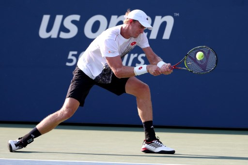 Kevin Anderson of South Africa returns the ball during his men's singles second round match against Jeremy Chardy of France on Day Three of the 2018 US Open at the USTA Billie Jean King National Tennis Center on August 29, 2018 in the Flushing neighborhood of the Queens borough of New York City.   Al Bello/Getty Images/AFP