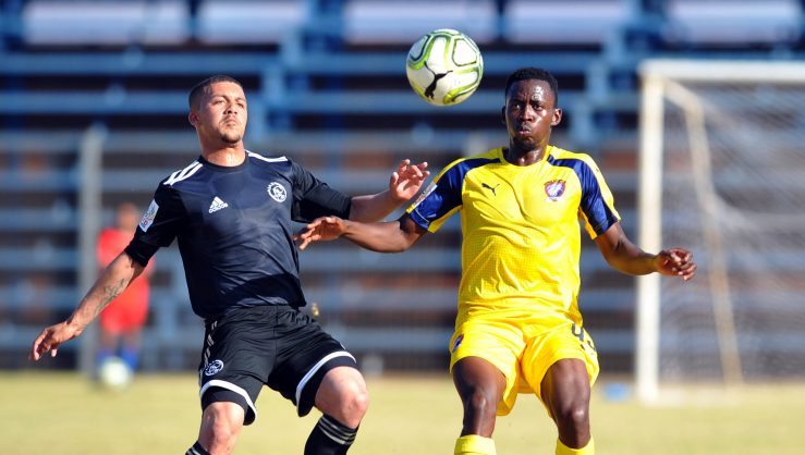 Grant Magerman of Ajax Cape Town challenges Tebogo Mabula of Jomo Cosmos  during the National First Division  match between Jomo Cosmos and  Ajax Cape Town at Vosloorus Stadium (Pic Sydney Mahlangu/BackpagePix)