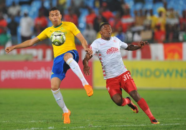 Ricardo Nascimento of Mamelodi Sundowns is challenged by Sabelo Nyembe of Highlands Park  during the Absa Premiership match between Mamelodi Sundowns and Highlands Park  at Loftus Versfeld Stadium / Pic Sydney Mahlangu/BackpagePix
